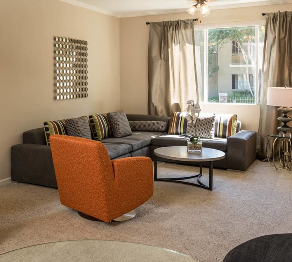 Large living room with plush carpeting at Alicante Apartment Homes in Aliso Viejo, California