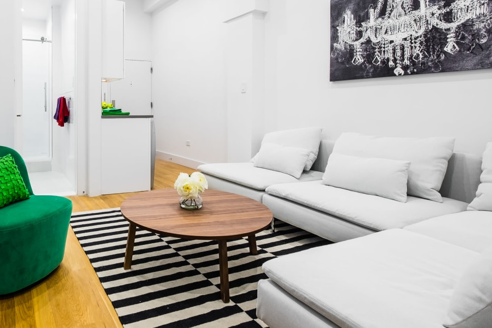 Living room with wood-style flooring at 210-220 E. 22nd Street in New York, New York