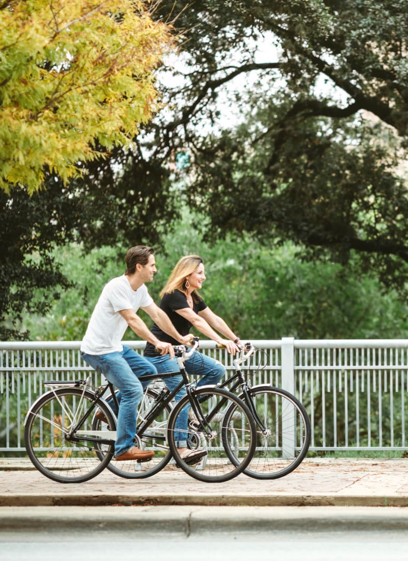 Residents riding bikes in Kingwood, Texas from Marquis at Kingwood