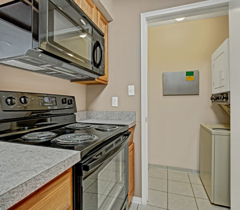 Kitchen with a washer and dryer at The Lakes of Schaumburg in Schaumburg, Illinois