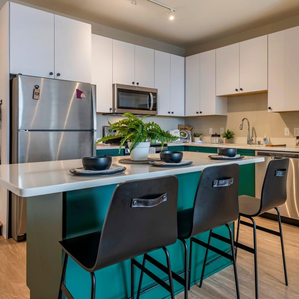 Bright kitchen with wood style flooring at UNCOMMON Dinkytown in Minneapolis, Minnesota