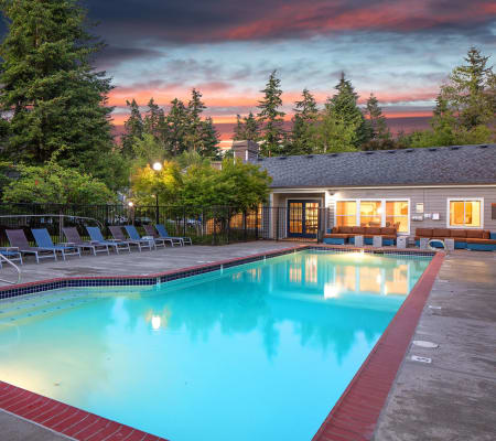 Large swimming pool at dusk at The Carriages at Fairwood Downs in Renton, Washington