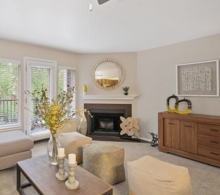 Beautiful living room with neutral colors centered around the fireplace in Waterhouse Place in Beaverton, Oregon