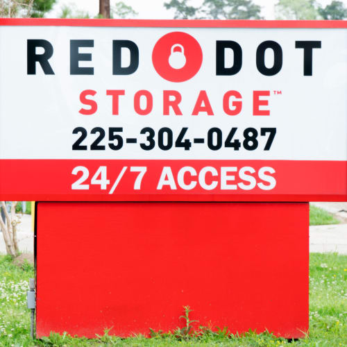 Sign at the street entrance of Red Dot Storage in Denham Springs, Louisiana