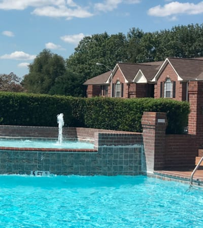 Fountain and swimming pool at Annandale Gardens in Olive Branch, Mississippi
