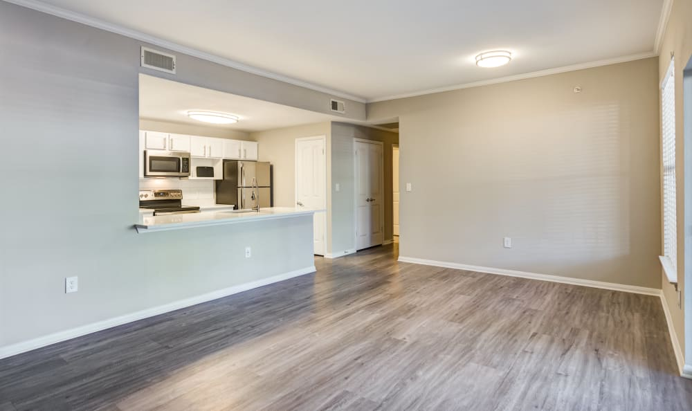Spacious open-concept layout with hardwood floors in a model home at Riata Austin in Austin, Texas