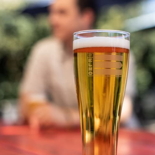 Refreshing pint of beer on a table outside at a bar near 44 South in Austin, Texas