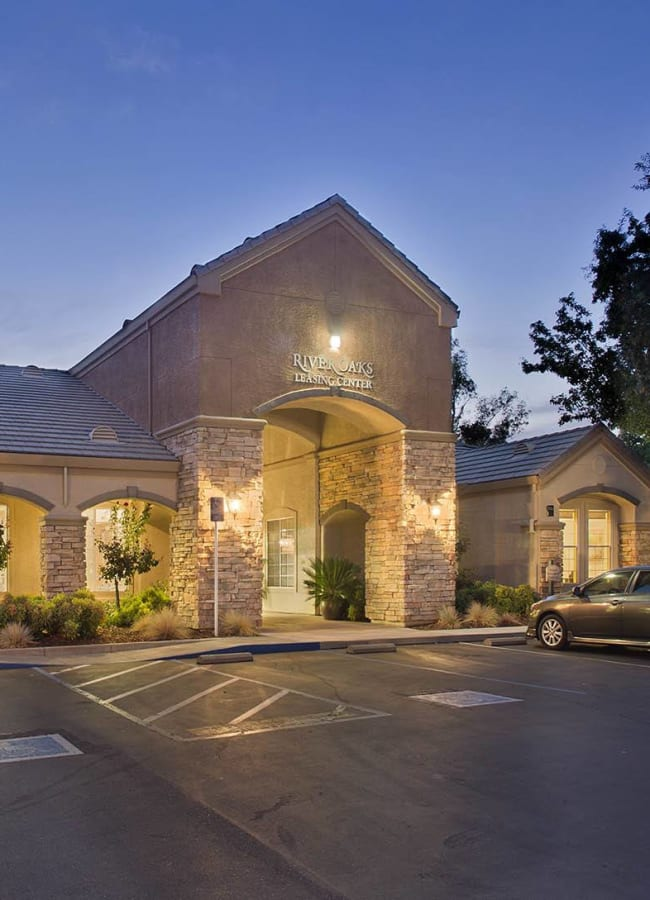 Exterior of the clubhouse at dawn at River Oaks Apartment Homes in Vacaville, California