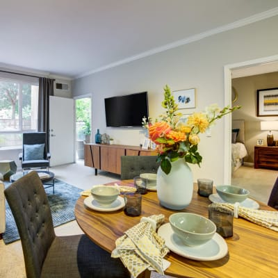 Well-furnished dining and living areas in a model home at Villa Del Sol in Sunnyvale, California