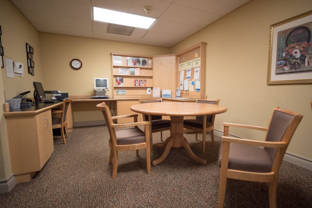 Business center with table, computer and printer available at Kenmore Senior Living in Kenmore, Washington