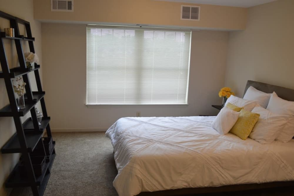 Well decorated bedroom at Greenwood Cove Apartments home in Rochester, NY