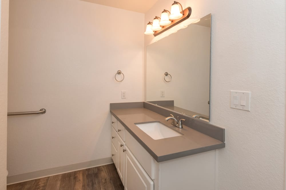 Model bathroom with unique accent lighting at Sterling Heights Apartment Homes in Benicia, California
