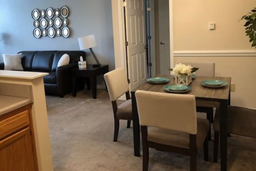 A set table in a dining room at Aspen Pines Apartment Homes in Wilder, Kentucky