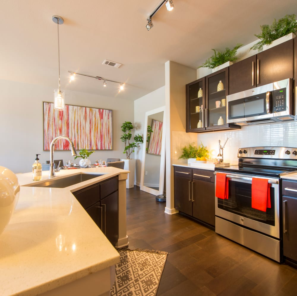 Kitchen with stainless-steel appliances at Elite 99 West in Katy, Texas