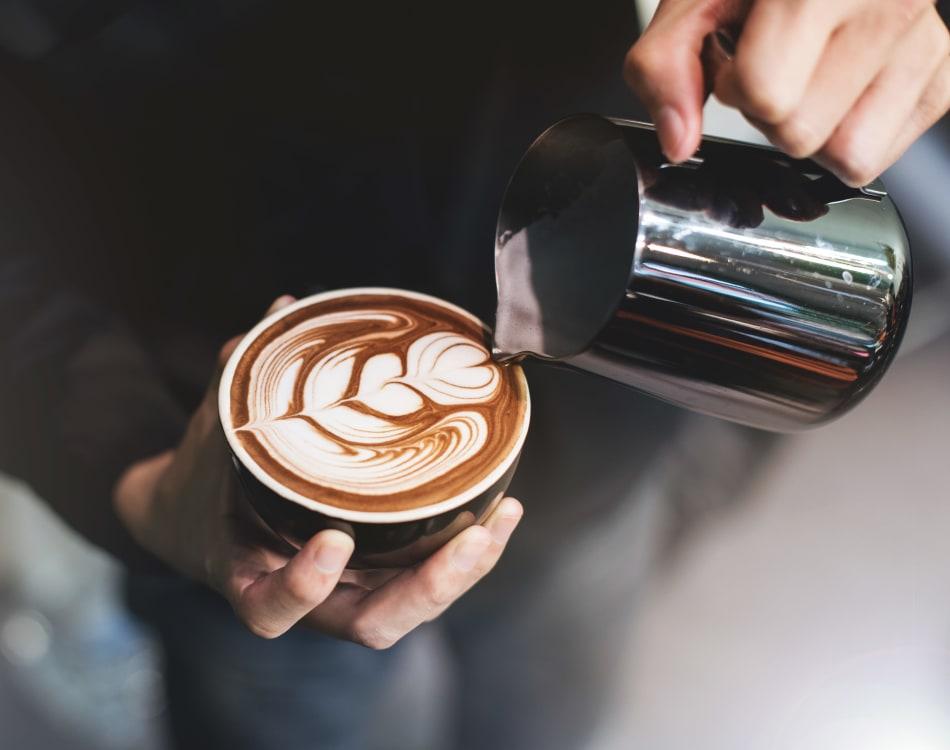 Barista making a latté for a customer near Vue Los Feliz in Los Angeles, California
