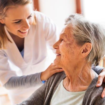 A caregiver checking in on a resident at Arbor Glen Senior Living in Lake Elmo, Minnesota