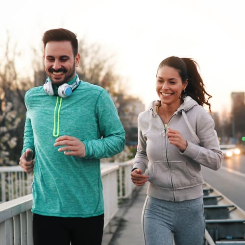 Couple jogging in Clarkston, Georgia near Reserve at Twin Oaks