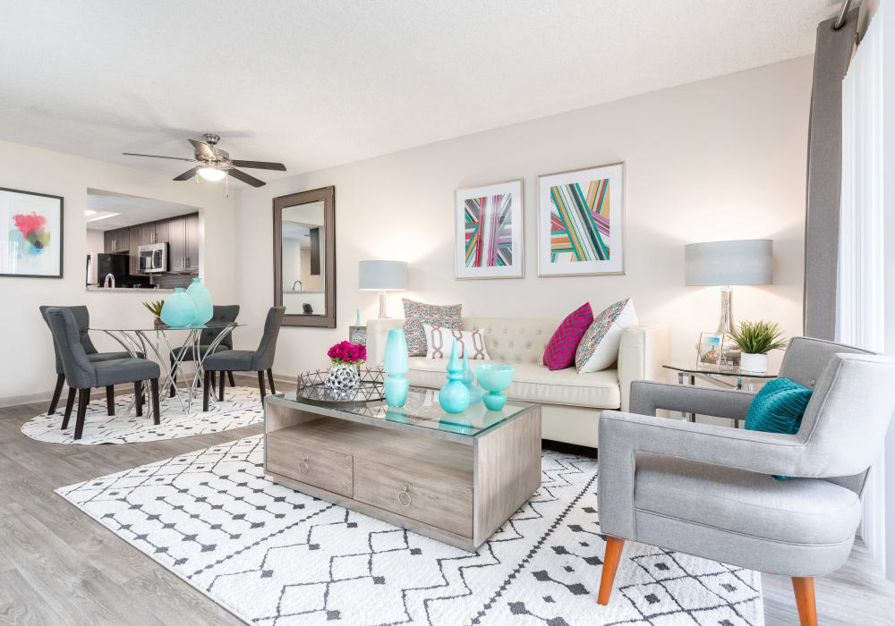 Modern decor in open-concept living area in model home at Siena Apartments in Plantation, Florida
