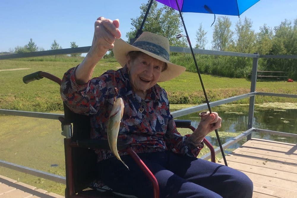 Resident MaryLou fishes in the pond at Clover Ridge Place in Maquoketa, Iowa.