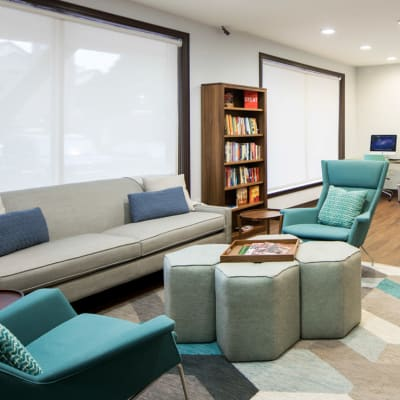 Beautifully decorated lobby interior with comfortable seating at Sofi Gaslight Commons in South Orange, New Jersey