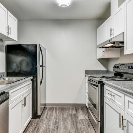 Newly Renovated white kitchen view with stainless steel appliances at ((location_name}}