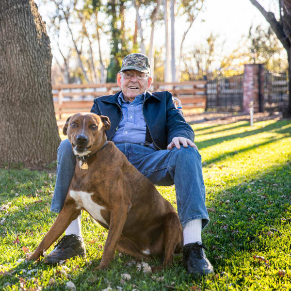 A man and his dog at The Atrium at Carmichael in Carmichael, California
