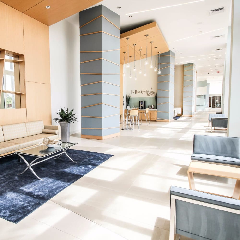 Large modern hallway with comfortable seating in the clubhouse at Midtown 24 in Plantation, Florida