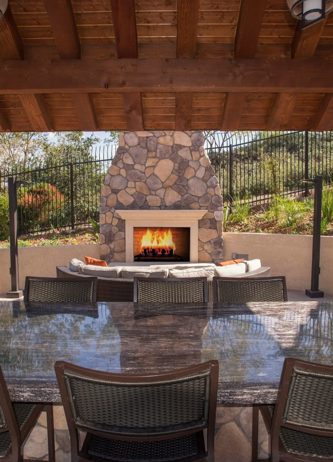 Cabana with a large table for entertaining guests at Shadow Ridge Apartment Homes in Simi Valley, California