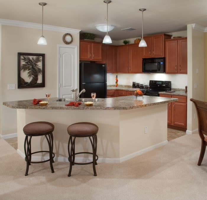 Dining room and kitchen in apartment at Villa Grande on Saxon in Orange City, Florida