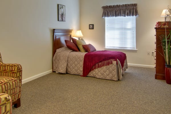 Assisted living apartment with a spacious bedroom at Parkway Gardens Senior Living in Fairview Heights, Illinois