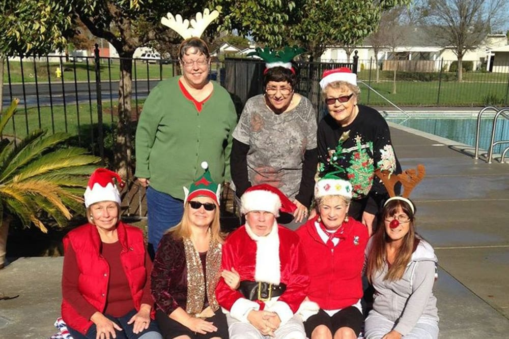 Christmas by the pool at a senior living community in Atwater, California at Castle Vista Senior Duplex Community