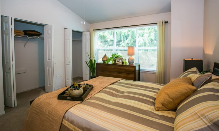 Bright model bedroom at The Colonnade Luxury Townhome Rentals in Hillsboro, Oregon