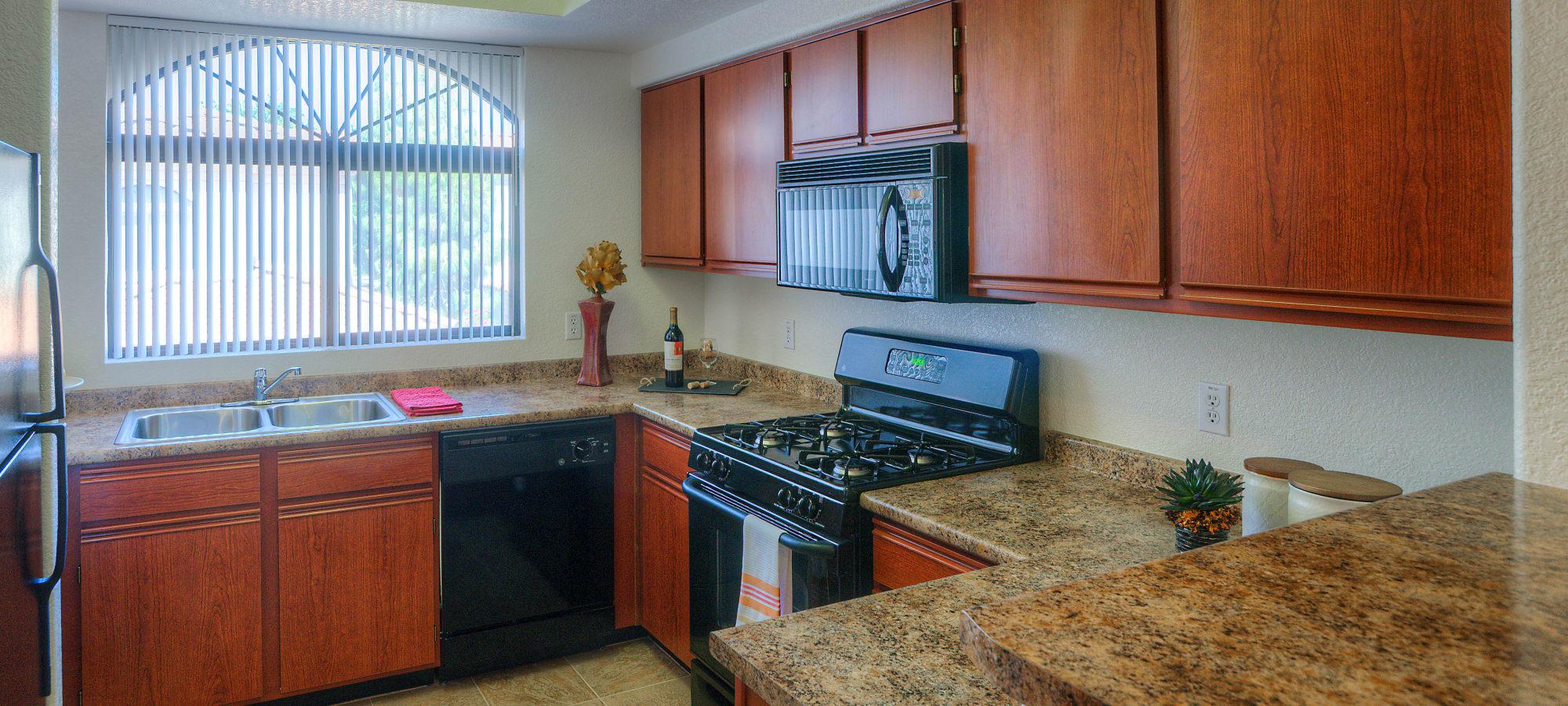 Kitchen featuring granite countertops at San Prado in Glendale, Arizona