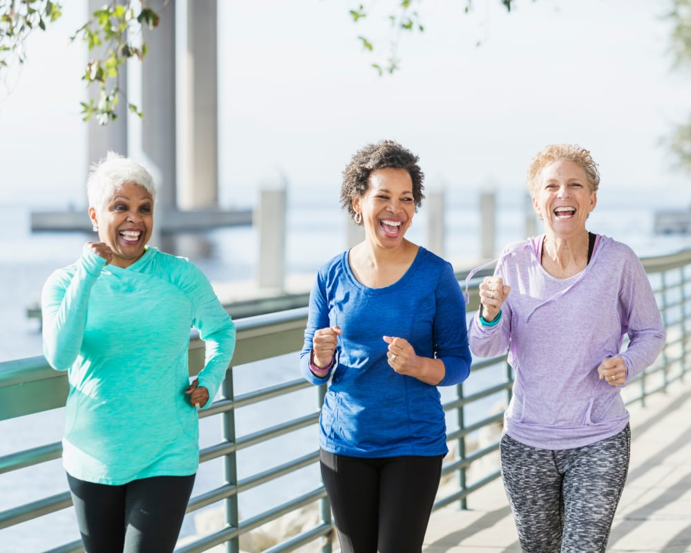 A group of residents jogging at Harmony at Harbour View in Suffolk, Virginia