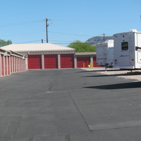 RVs parked near outdoor units at StorQuest Self Storage in Apache Junction, Arizona