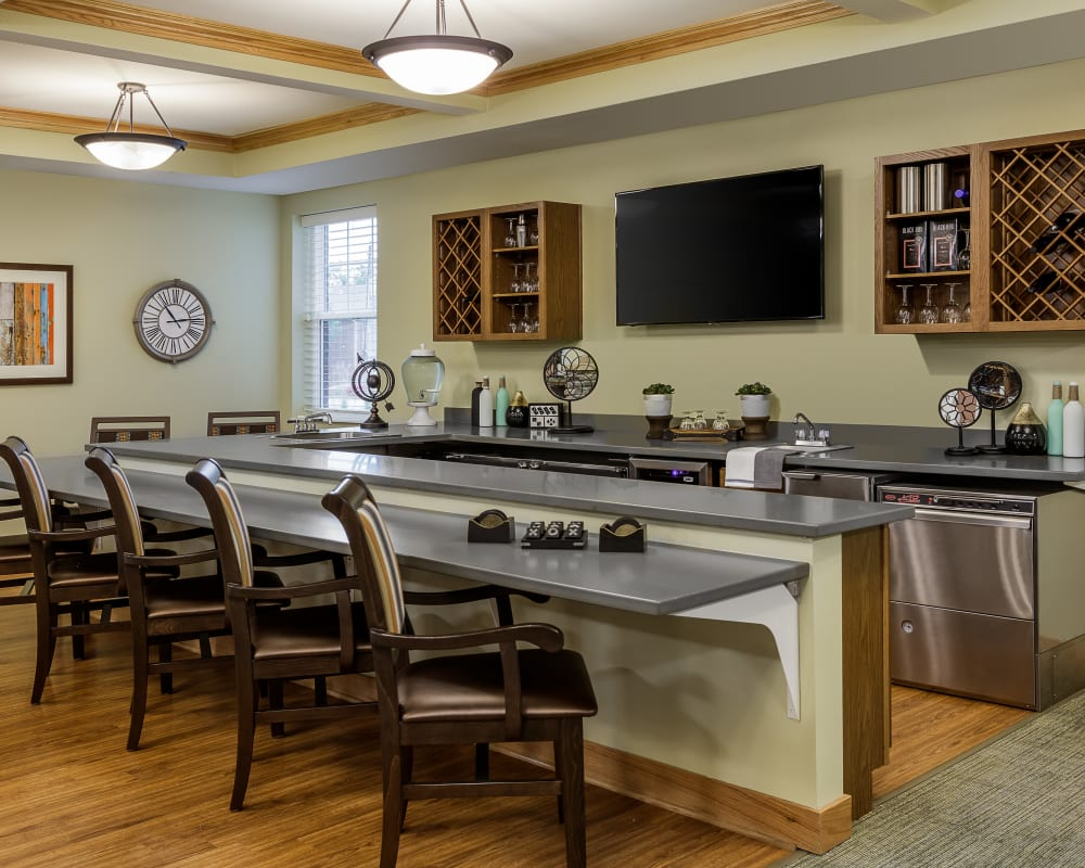 Community kitchen with a serving bar at Edencrest at Beaverdale in Des Moines, Iowa.