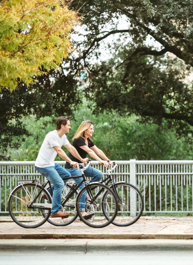 Friends biking near Marquis at Legacy in Plano, Texas