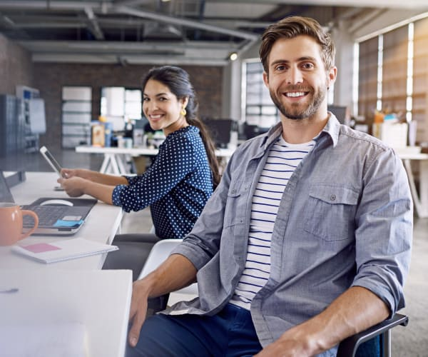 Couple sitting at office table in Denver