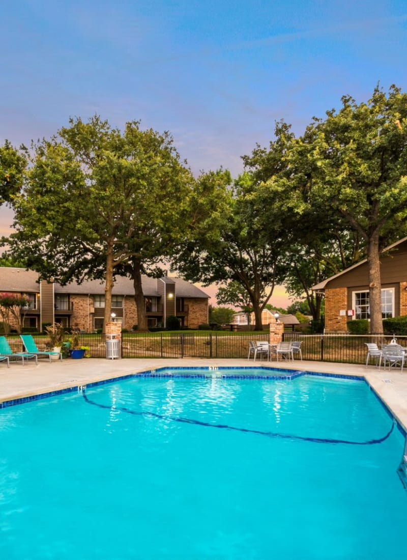 Bright pool with trees behind at The Park at Flower Mound in Flower Mound, Texas