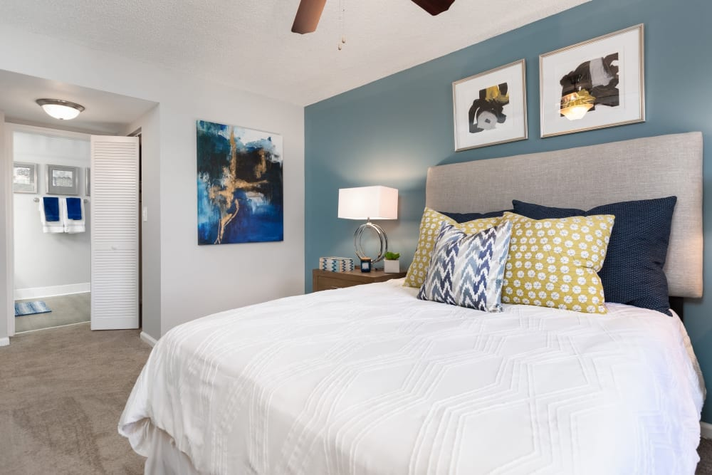 Large main bedroom in model home with ceiling fan and large closet at Beach Walk at Sheridan in Dania Beach, Florida
