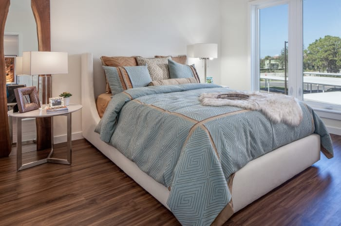 Model bedroom at All Seasons Naples in Naples, Florida