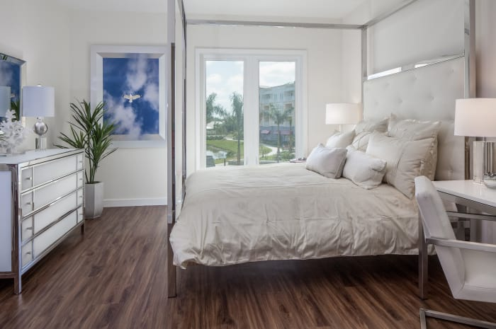Bright bedroom at All Seasons Naples in Naples, Florida
