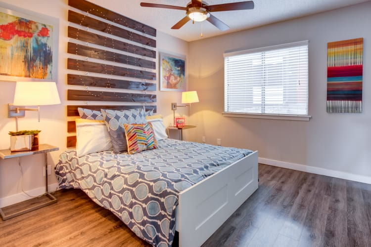 Well-decorated master bedroom with a ceiling fan in a model home at Array Apartments in Austin, Texas