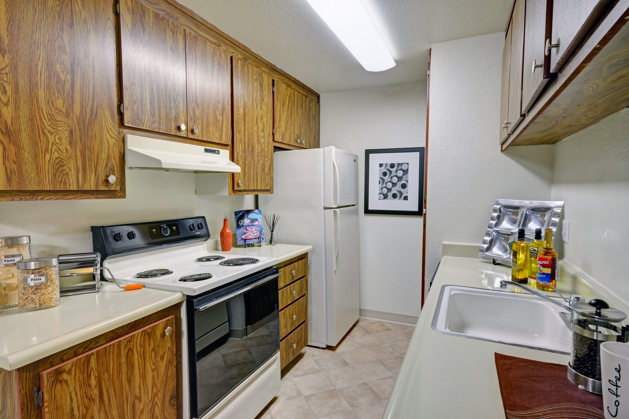 A fully equipped kitchen at Avery Park Apartments