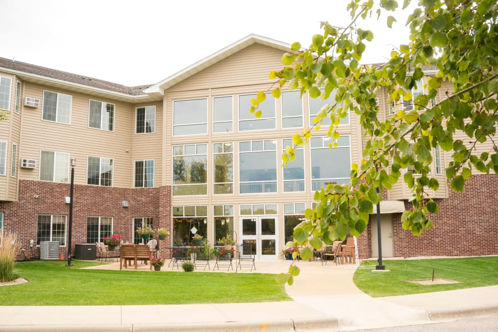 Exterior view of apartment buildings and courtyard at Prairie Meadows Senior Living in Kasson, Minnesota.