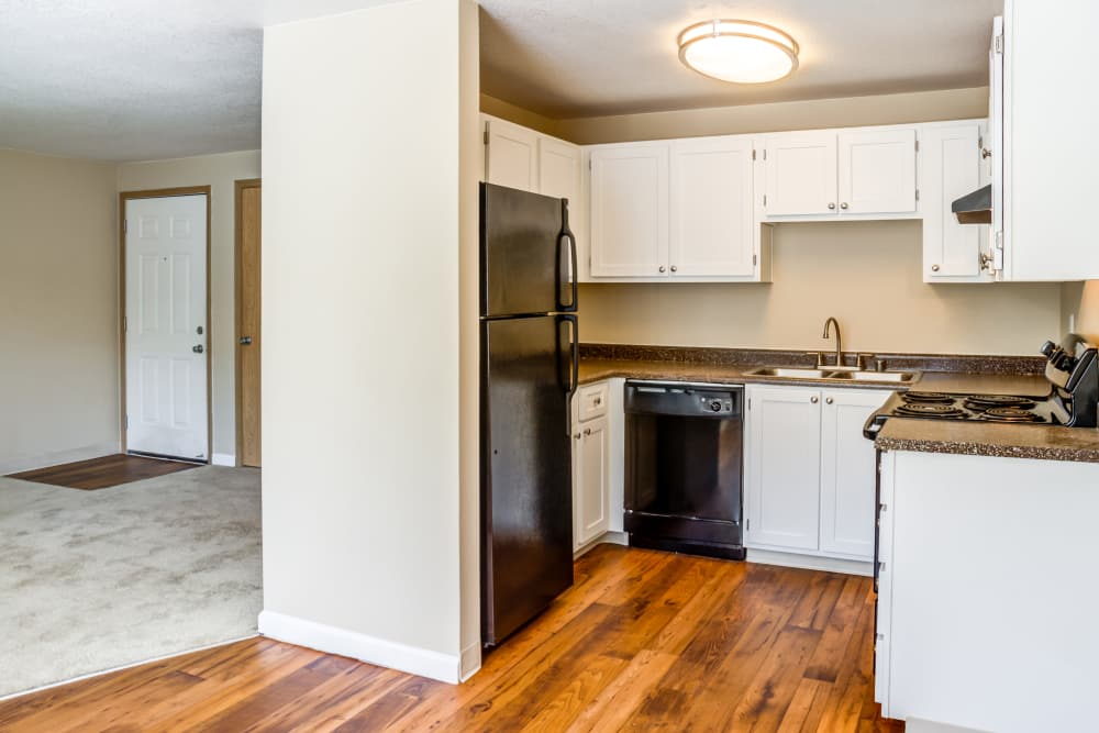 Living room and kitchen at Madison Park Apartments in Vancouver, Washington