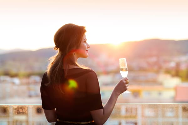 Women enjoying wine on her private balcony at Shadow Hills at Lone Mountain in Las Vegas, Nevada