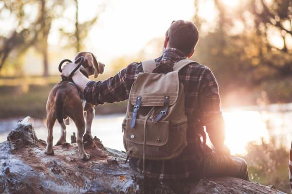 Man sitting with his dog in Austin near Alta Tech Ridge