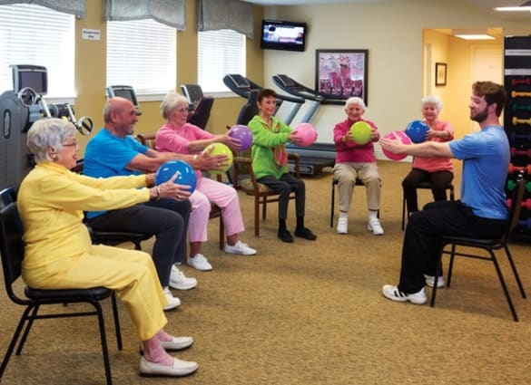 Residents at Burr Ridge Senior Living participating in a fitness class