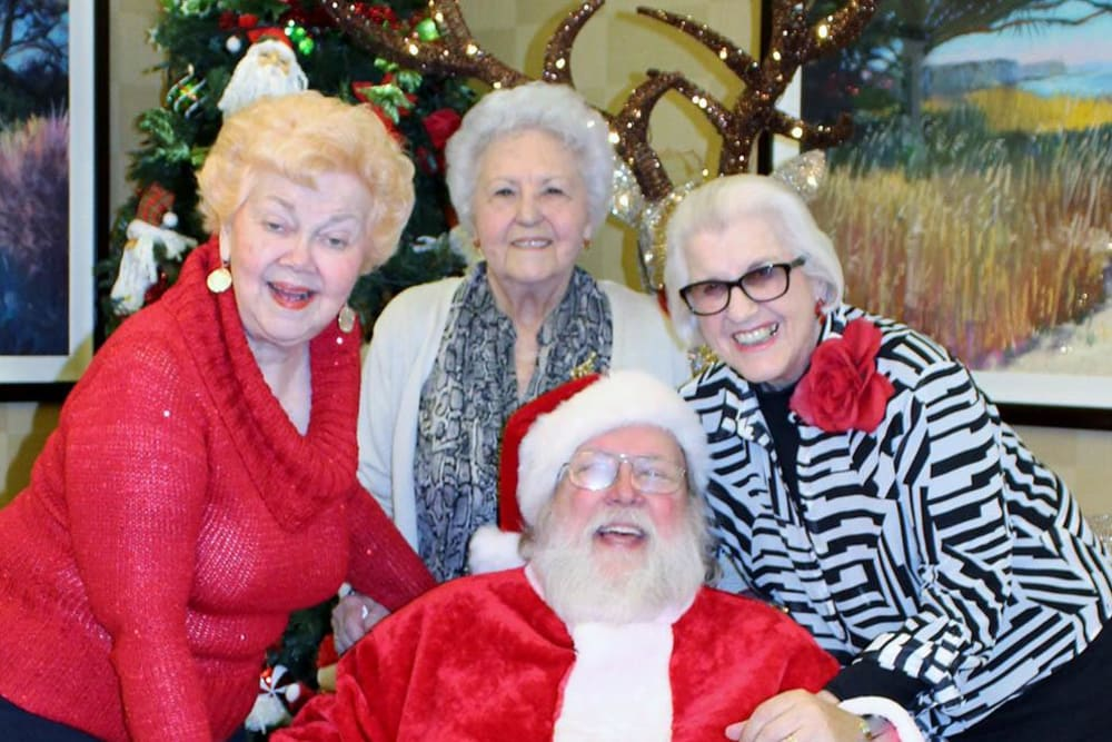 Residents with Santa at Merrill Gardens at Santa Maria in Santa Maria, California